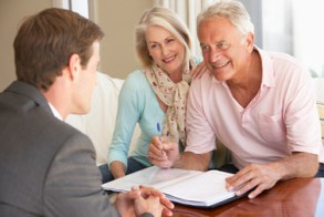 Retired Couple Working With Advisor