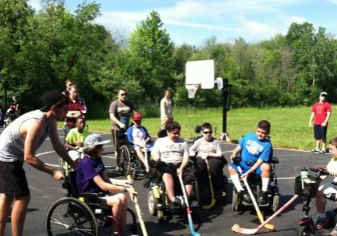 Kids Enjoying Playground Hockey