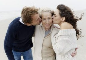 Son and Daughter Kissing Mom on Cheek